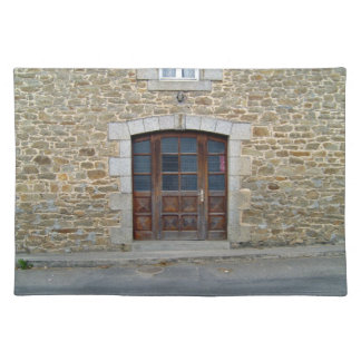 A vintage door and window in stone wall place mats
