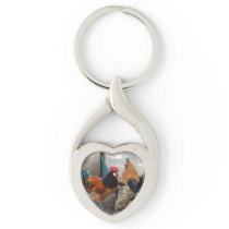 A Vorwerks Chicken pair, Rooster and Hen Eating Keychain