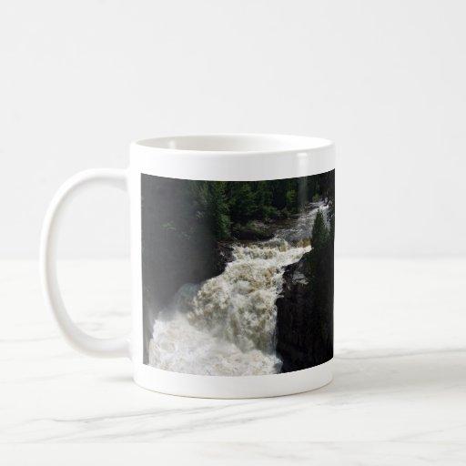 A waterfall with trees and rocks coffee mugs