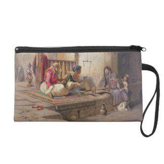 A weaver in Esna, one of 24 illustrations produced Wristlet Clutches