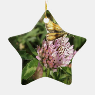 A wee moth on a wee flower ceramic ornament