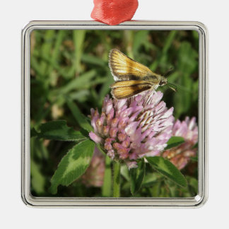 A wee moth on a wee flower metal ornament