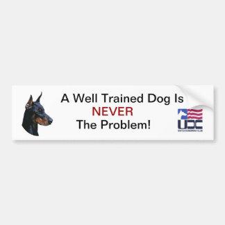 A Well Trained Dog - Black Bumper Sticker