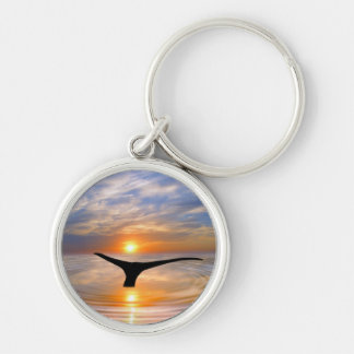 A whales tail at sunset Silver-Colored round keychain