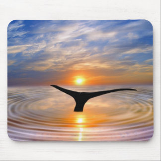 A whales tail at sunset mouse pad