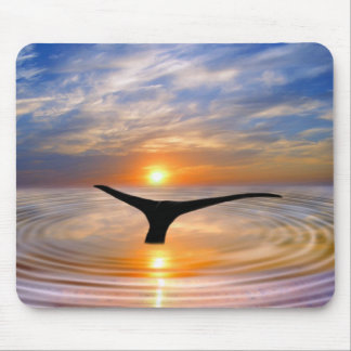 A whales tail at sunset mousepads