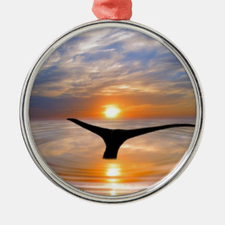 A whales tail at sunset round metal christmas ornament