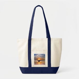 A whales tail at sunset tote bag