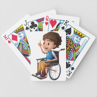 A wheelchair with a boy bicycle playing cards
