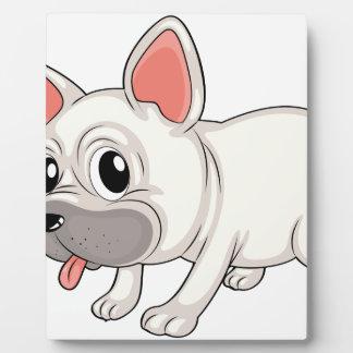 A white bulldog display plaque