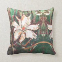 A white flower throw pillow