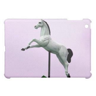 A white horse carousel statue against purple iPad mini cover