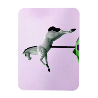A white horse carousel statue against purple rectangular magnet