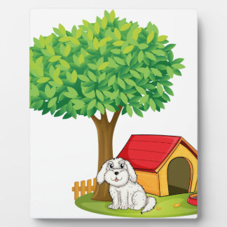 A white puppy beside a doghouse under a big tree display plaques