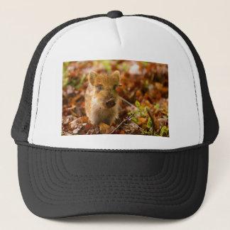 A Wild Boar Piglet Sus Scrofa in the Autumn Leaves Trucker Hat
