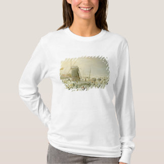 A winter scene with skaters by a windmill T-Shirt