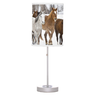 A winter scenic of running horses on The 2 Desk Lamp