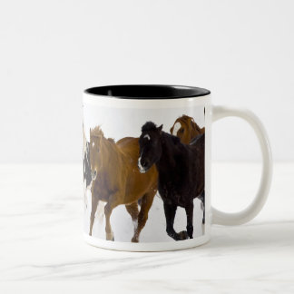 A winter scenic of running horses on The Two-Tone Coffee Mug