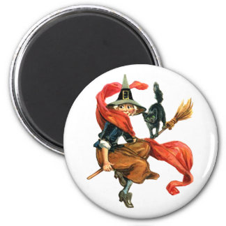 A Witch Flies on Her Broom with her Black Cat Magnet