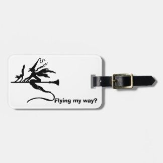A witch on a broomstick with a cat luggage tag