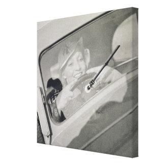 A woman driving, c.1930s (photogravure) canvas print