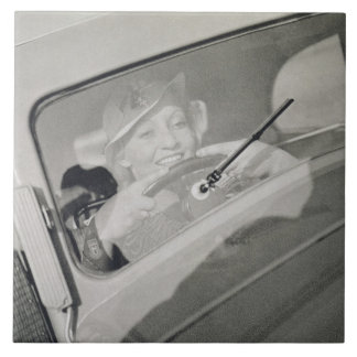 A woman driving, c.1930s (photogravure) ceramic tile