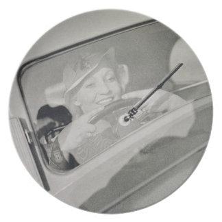 A woman driving, c.1930s (photogravure) melamine plate