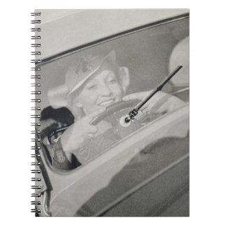 A woman driving, c.1930s (photogravure) notebook