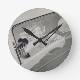 A woman driving, c.1930s (photogravure) round clock