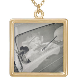 A woman driving, c.1930s (photogravure) square pendant necklace