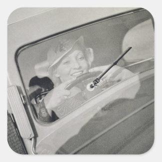 A woman driving, c.1930s (photogravure) square sticker