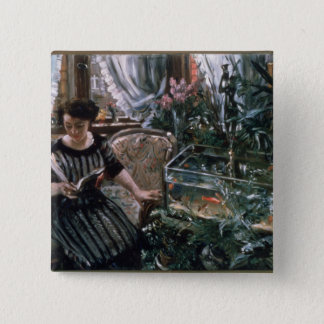A Woman Reading near a Goldfish Tank Pinback Button
