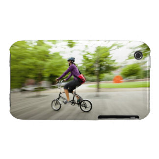 A woman using a folding bike to commute Case-Mate iPhone 3 cases