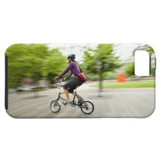 A woman using a folding bike to commute iPhone 5 covers