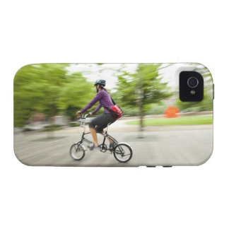A woman using a folding bike to commute iPhone 4 case