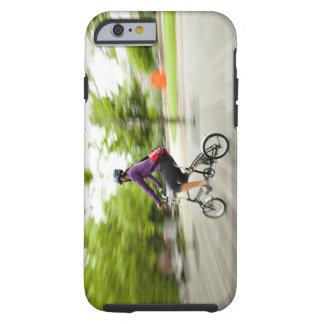A woman using a folding bike to commute tough iPhone 6 case