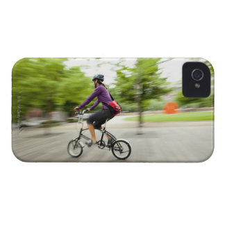 A woman using a folding bike to commute iPhone 4 covers