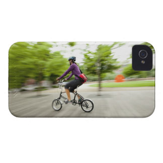 A woman using a folding bike to commute Case-Mate iPhone 4 cases