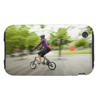 A woman using a folding bike to commute tough iPhone 3 cover