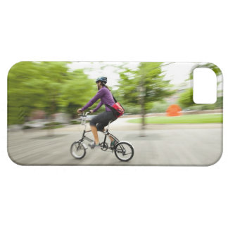A woman using a folding bike to commute iPhone 5 cases
