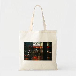 A woman walks in the city budget tote bag