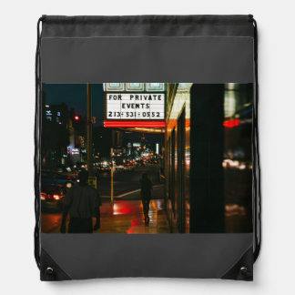 A woman walks in the city cinch bag