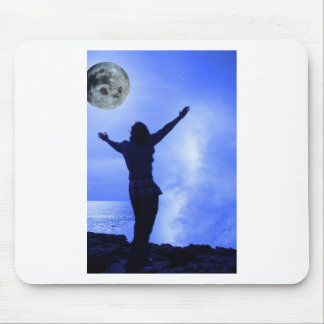 a woman with raised hands facing a wave and full m mouse pad