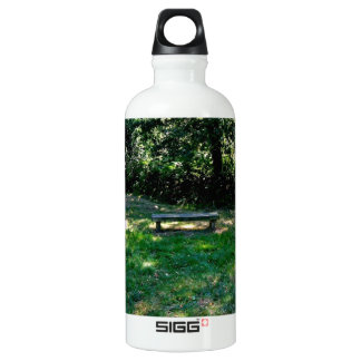 A wooden bench in the forest. SIGG traveler 0.6L water bottle
