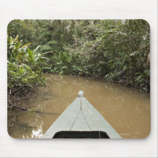 A wooden canoe made of Eucylptus tree floats in 2 Mouse Pad