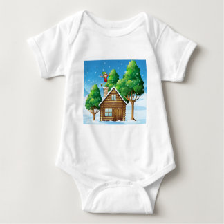 A wooden house with a playful elf at the rooftop baby bodysuit