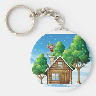 A wooden house with a playful elf at the rooftop keychain