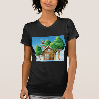 A wooden house with a playful elf at the rooftop shirt