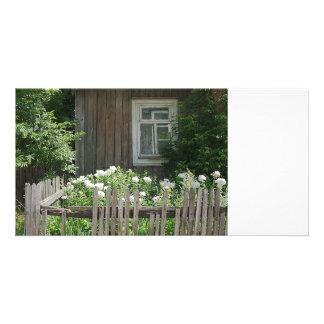 A wooden hut photocard card