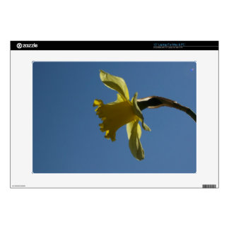 """A Yellow Daffodil Against Blue Sky 15"""" Laptop Skin"""